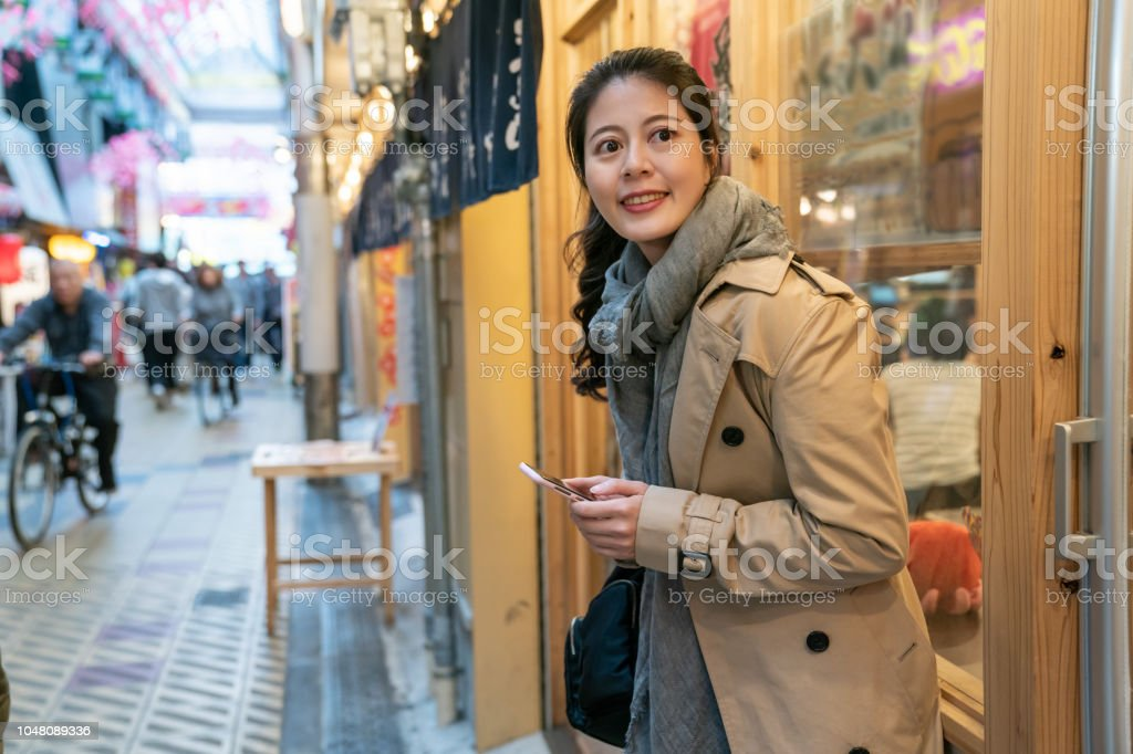 Lady relying on the store's window - Stock image .