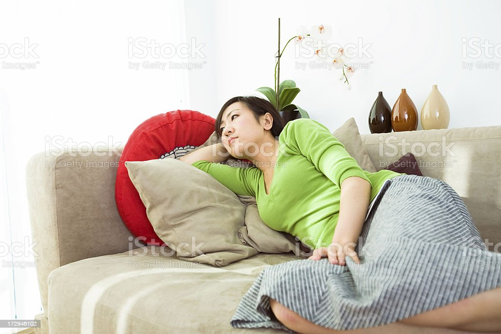 Lady resting on sofa royalty-free stock photo