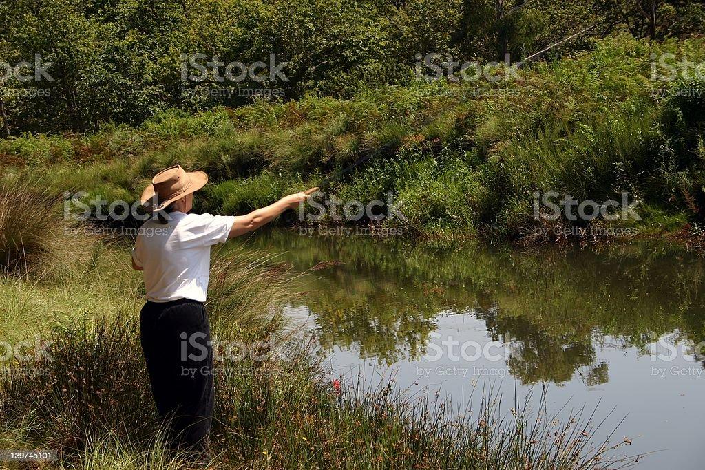 Lady river fishing royalty-free stock photo
