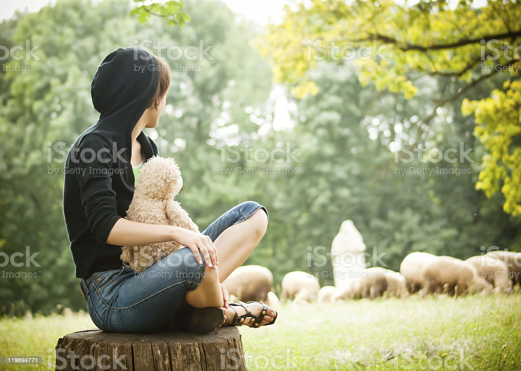 Lady seating outdoors royalty-free stock photo
