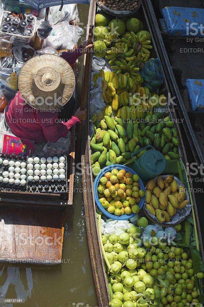 lady selling food at Floating market of Bangkok royalty-free stock photo