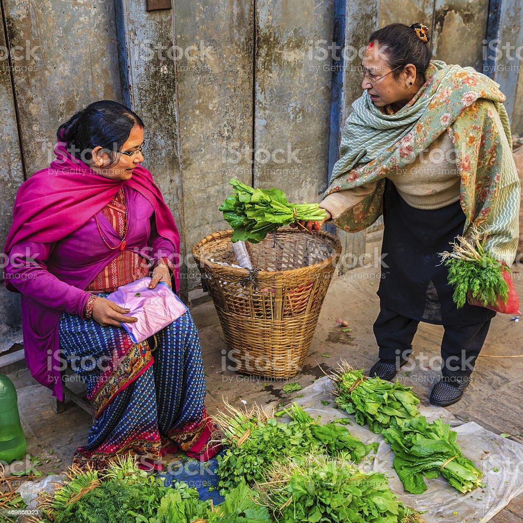 Lady selling vegetables on street in Kathmandu, Nepal royalty-free stock photo