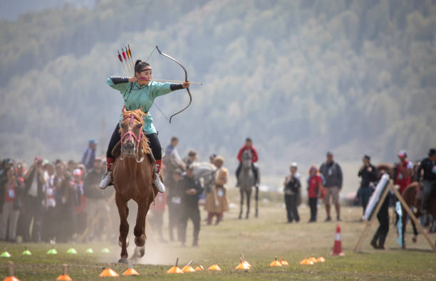 Lady shooting an arrow while riding a horse at world nomad games picture id1034710206?b=1&k=6&m=1034710206&s=612x612&w=0&h=bykxqd5jpsj0jfif4jlngddl70qd6cl08pocs5v8bbw=