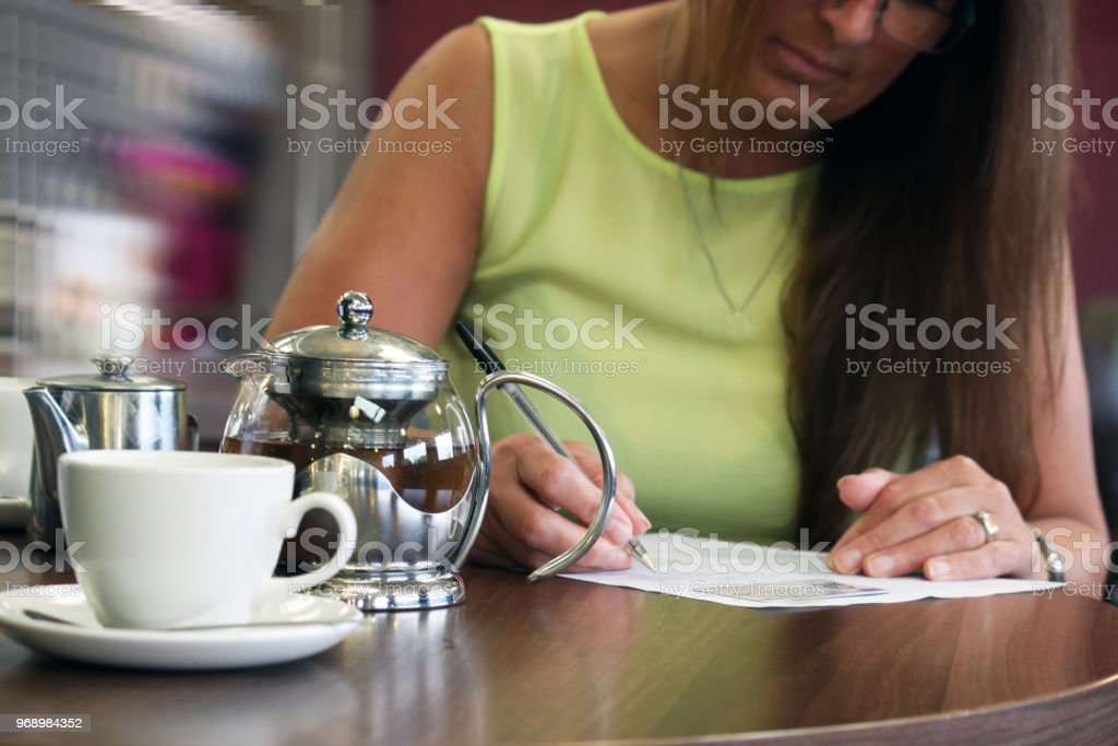 A lady signing a release stock photo