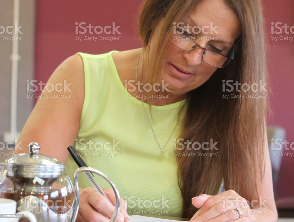 Lady signing an agreement stock photo
