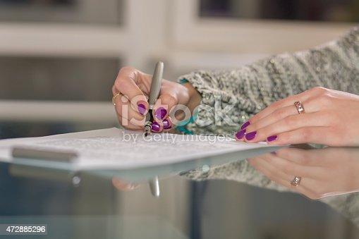 istock Lady signs contract 472885296
