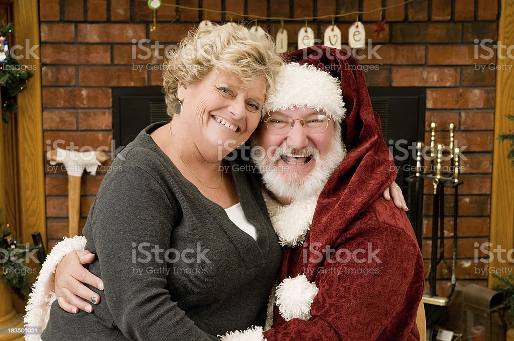 Lady sitting with Santa Claus stock photo