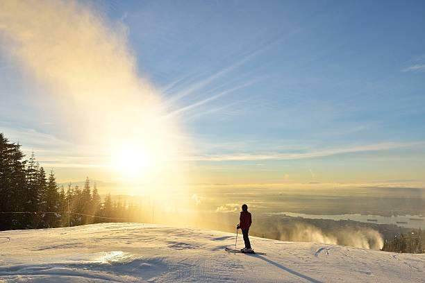 Lady Skier enjoy sunrise on Grouse Mountain stock photo
