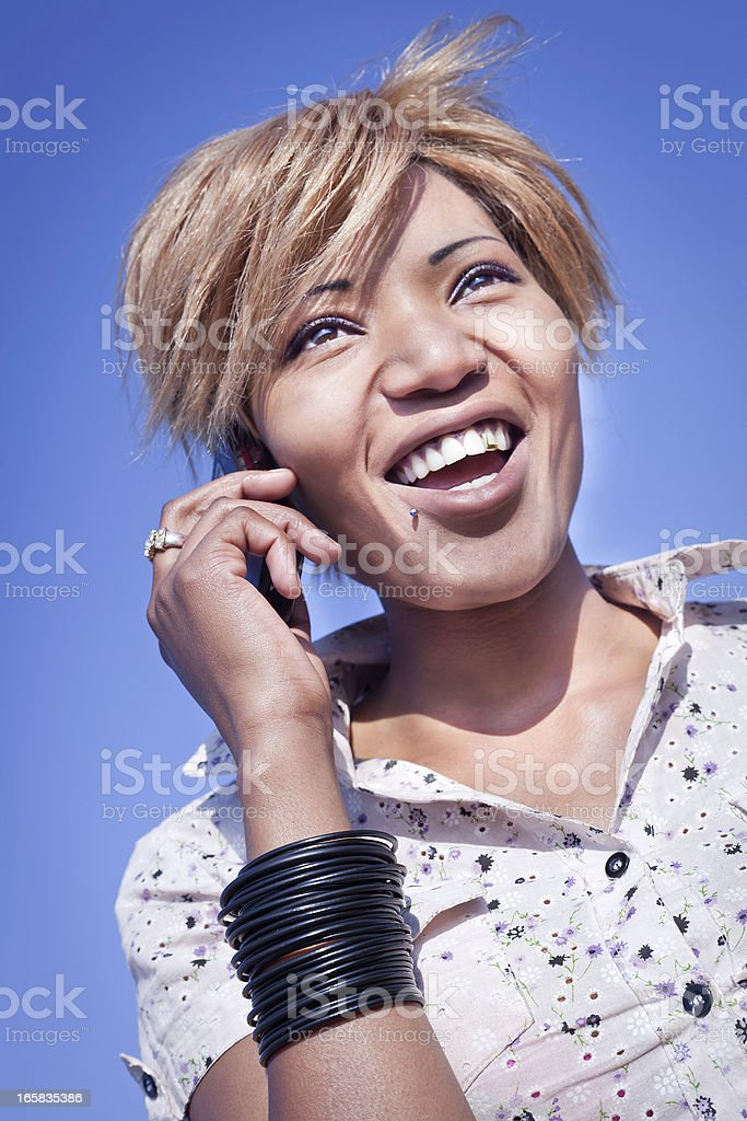 Lady talking on her mobile smiling stock photo
