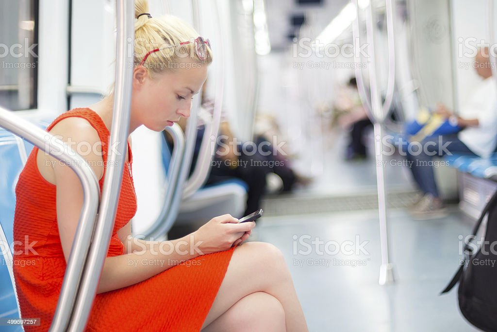 Lady traveling by metro. stock photo