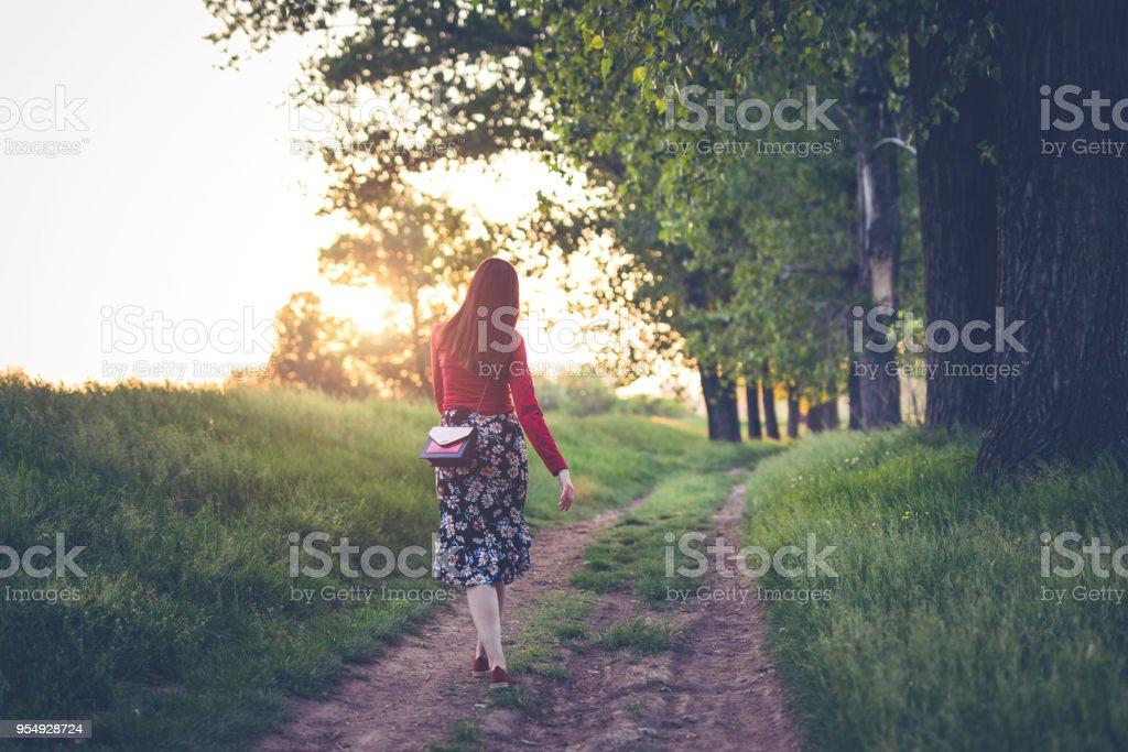 Lady walking alone. Copy space. stock photo