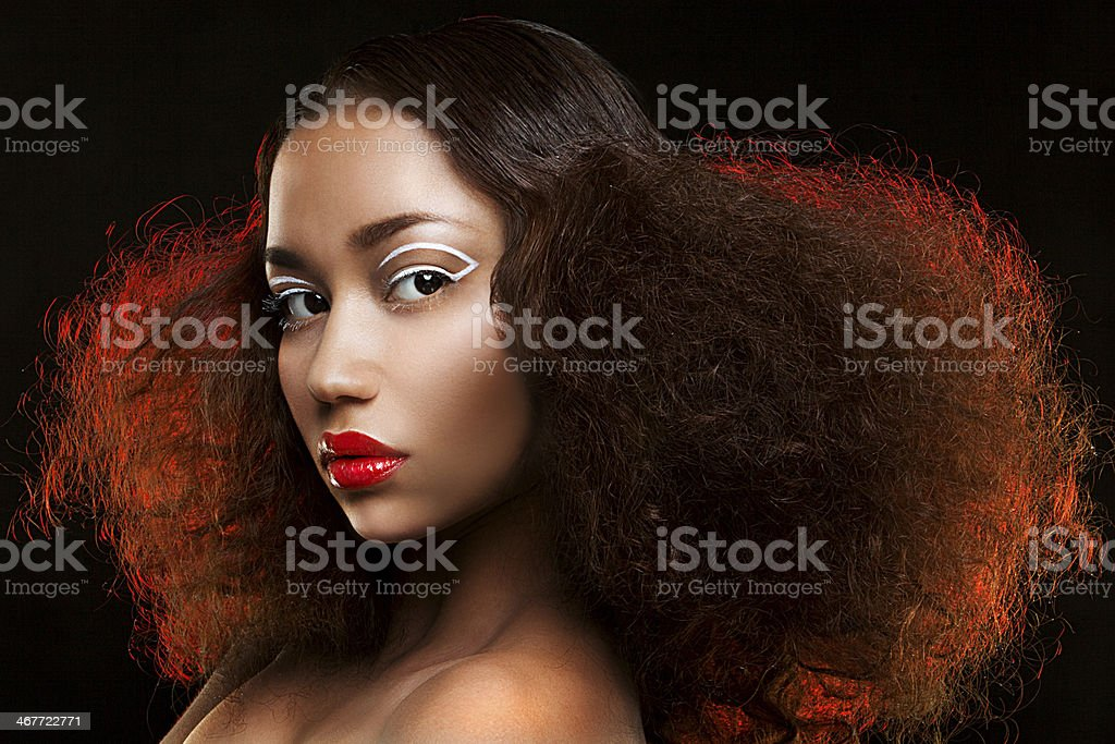Lady with beautiful hairstyle and unusual makeup stock photo
