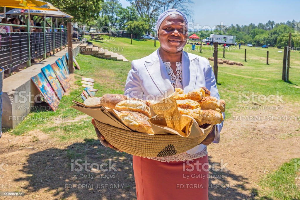 Lady with bread basket at Riversands farm Village in Fourways stock photo