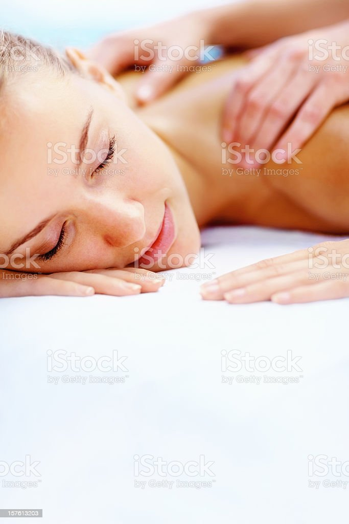 Lady with eyes closed getting a shoulder massage at spa royalty-free stock photo