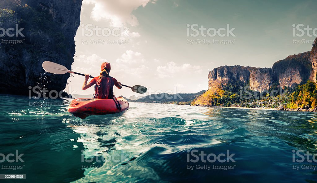 Lady with kayak stock photo