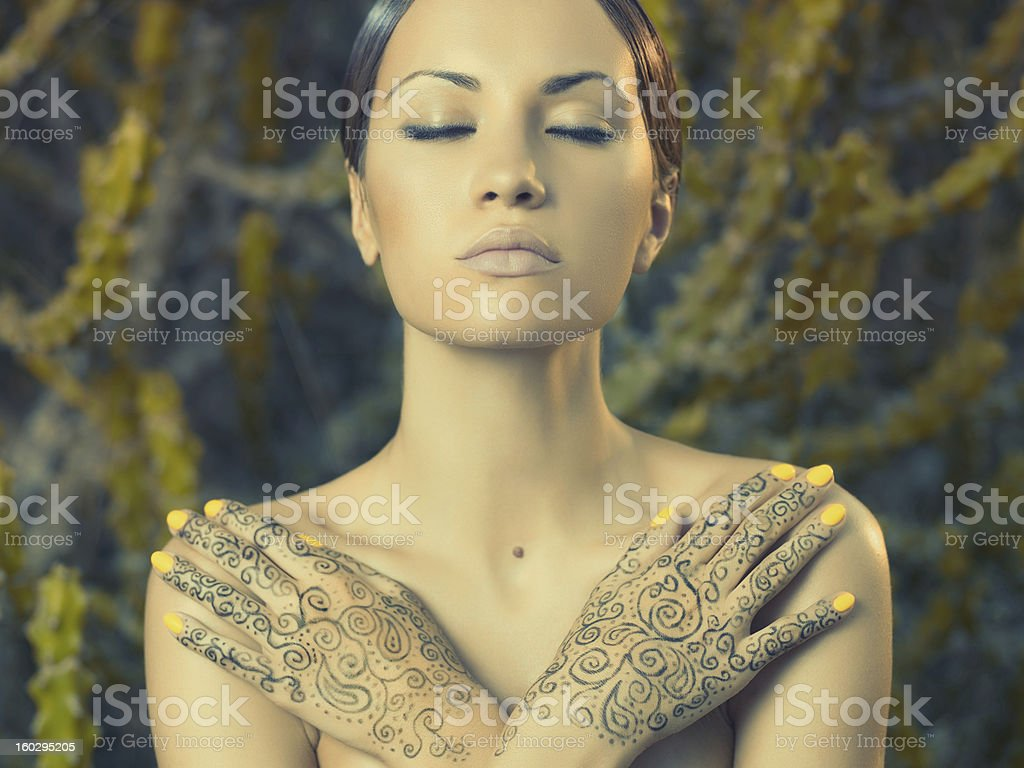Lady with painted hands mehendi royalty-free stock photo