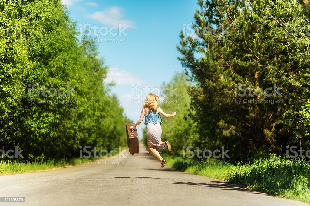 Lady with suitcase stock photo