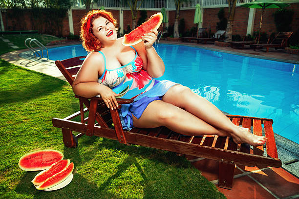lady with watermelon - funny fat lady stock photos and pictures