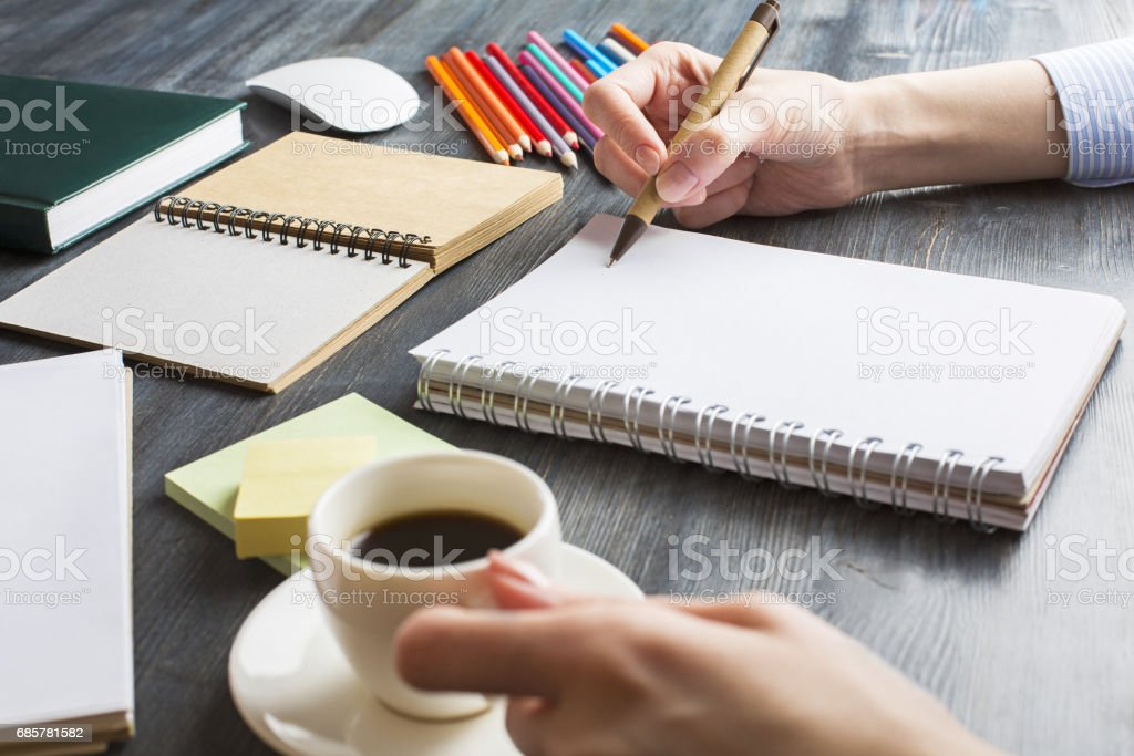 Lady writing in notepad royalty-free stock photo