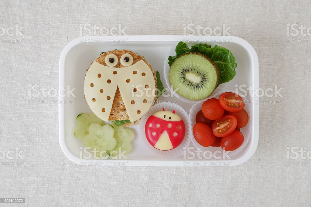 Ladybug ladybird healthy lunch box, fun food art for kids stock photo