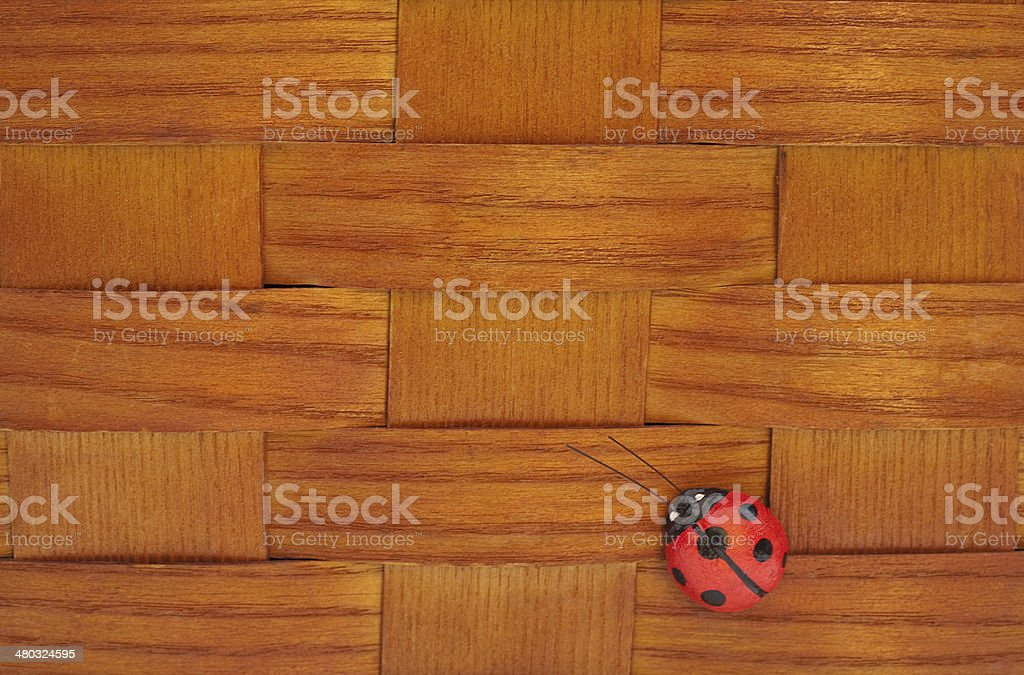 Ladybug on vintage wooden woven picnic basket stock photo