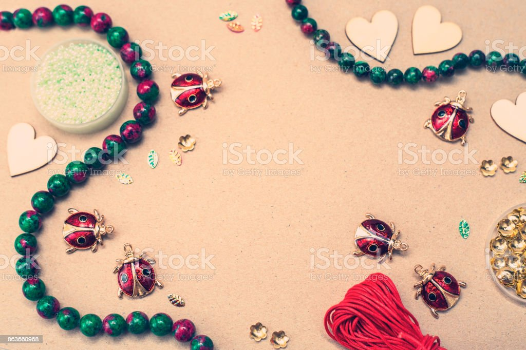 Ladybugs charms and tools stock photo