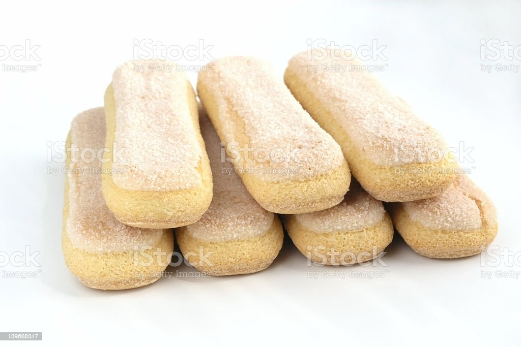Ladyfinger biscuits arranged in neat stack on white surface royalty-free stock photo