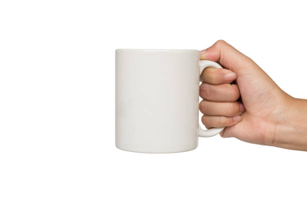 lady's hands holding cup isolated on white background. stock photo