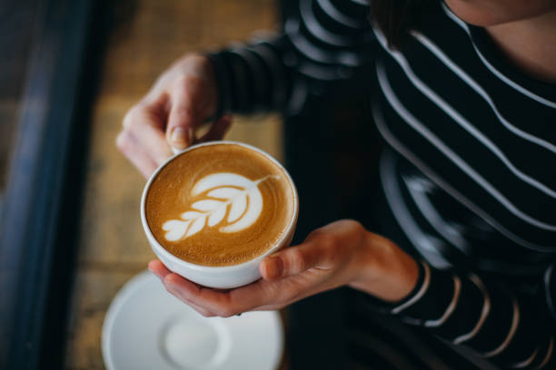 Lady's hands holding cup with sth heart-shaped Lady's hands holding cup with sth heart-shaped caffeine stock pictures, royalty-free photos & images