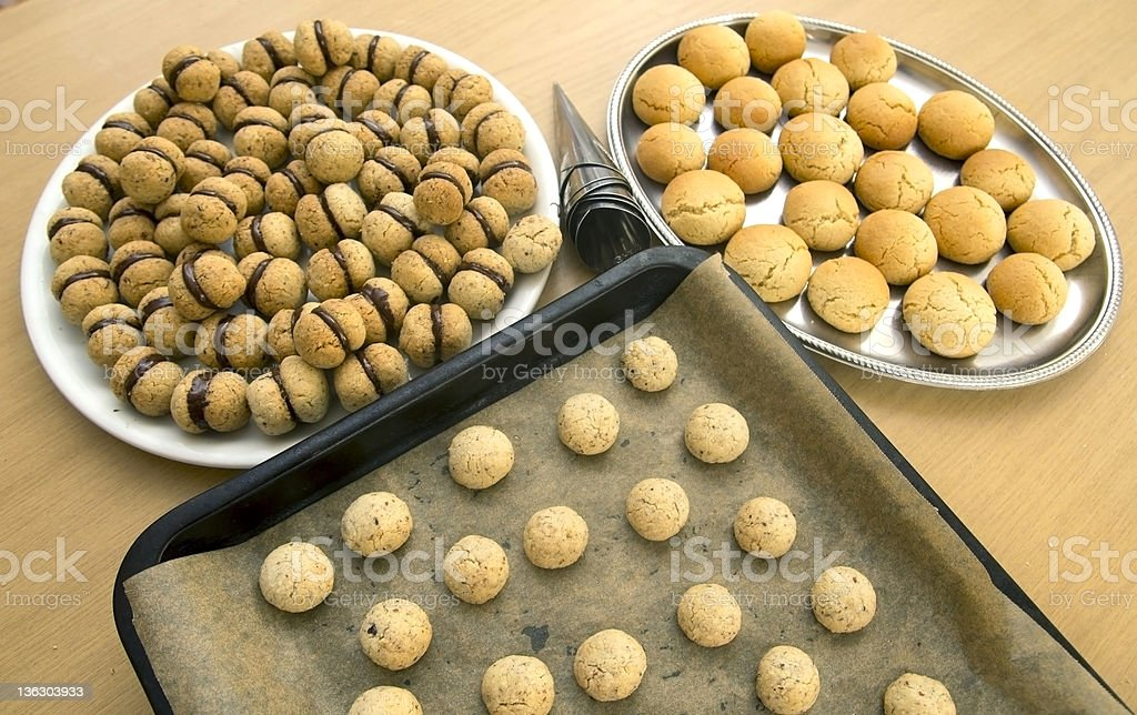 Lady's kisses and ginger biscuits with pastry tools royalty-free stock photo