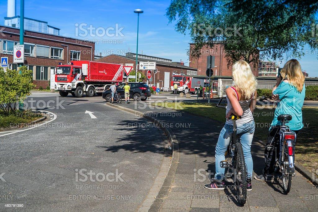 Ladys observing fire fighters at Chempark Uerdingen stock photo