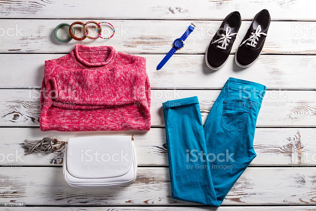 Lady's outfit with pink pullover. stock photo