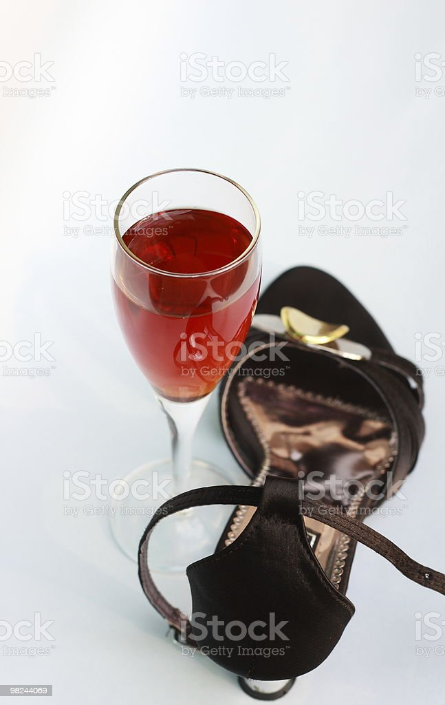lady's shoes and wine glass royalty-free stock photo