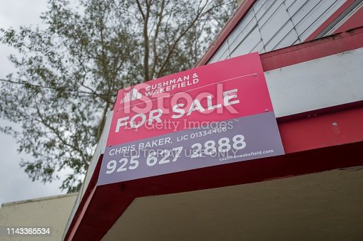 Lafayette, California, United States - April 04, 2019:  Close-up of For Sale sign from real estate brokerage Cushman and Wakefield on facade of the historic Park theater in Lafayette, California, April 4, 2019