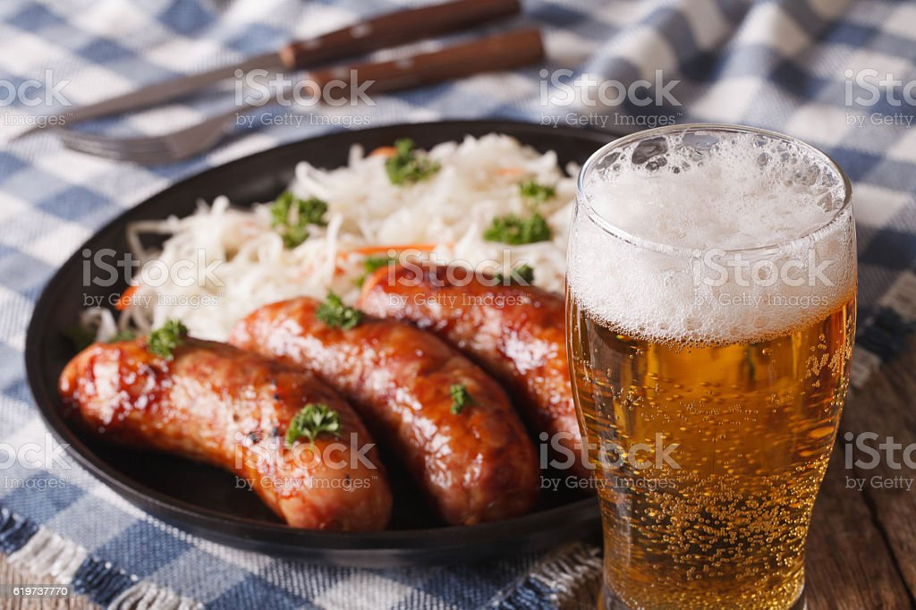 Lager beer and snacks of sausages and sauerkraut stock photo