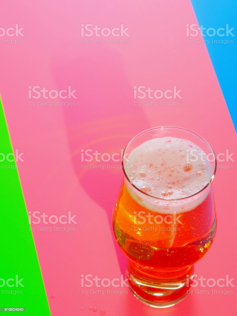 A Lager beer in uncommon glass stock photo