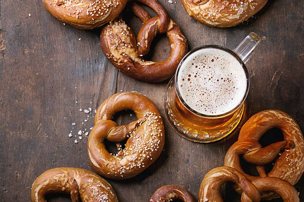lager beer with pretzels - german culture stock pictures, royalty-free photos & images
