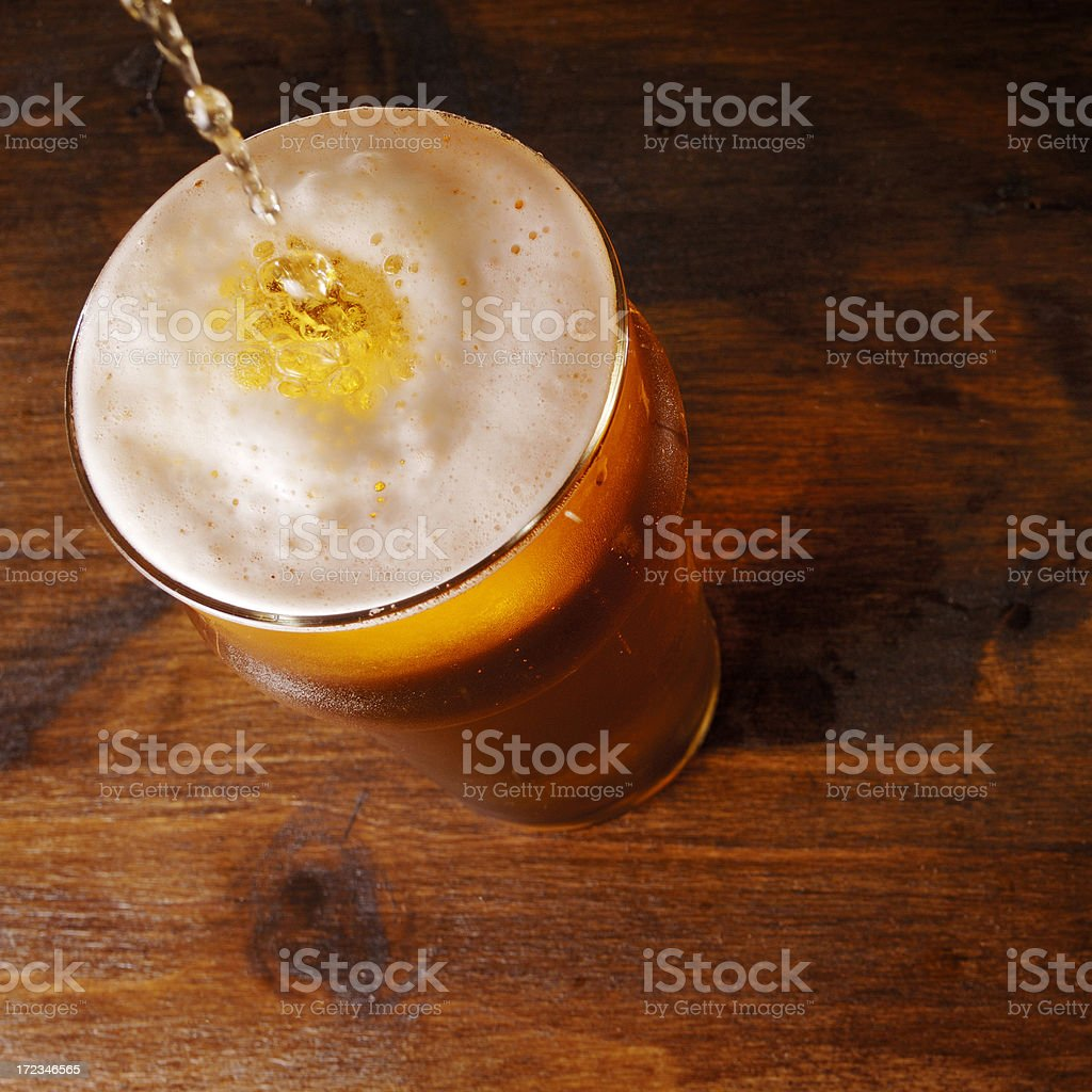 Lager pouring into pint glass royalty-free stock photo