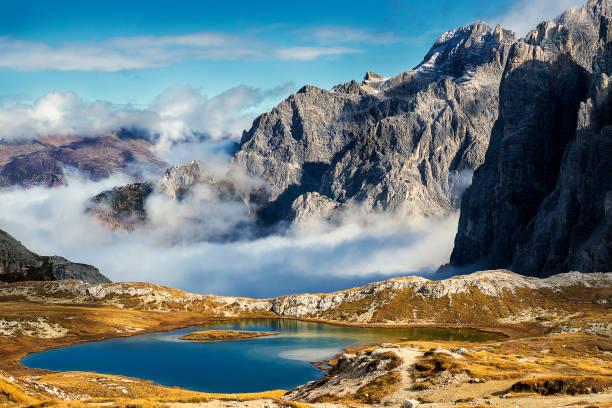 Laghi del piani lakes view and huge rocky mountains in Tre Cime di Lavaredo park stock photo