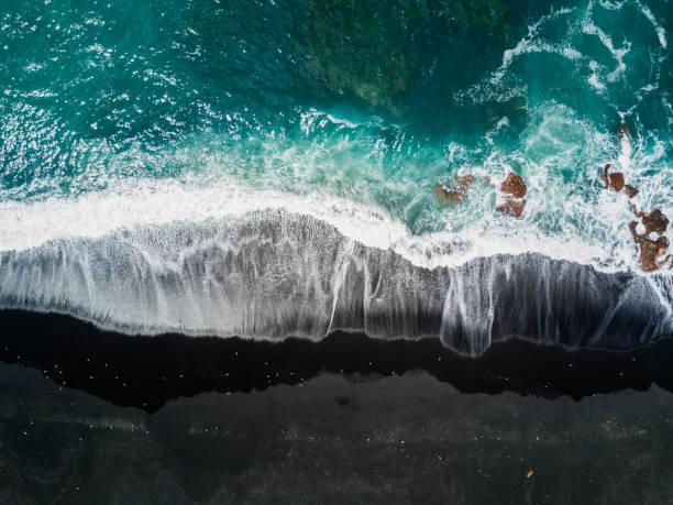 Lago de los clicos Lago de los clicos. Lanzarote,Spain. black sand stock pictures, royalty-free photos & images
