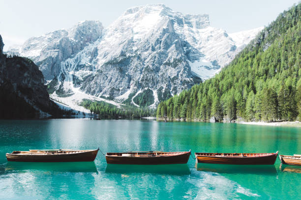 lago di braies during summer sunrise - latemar foto e immagini stock