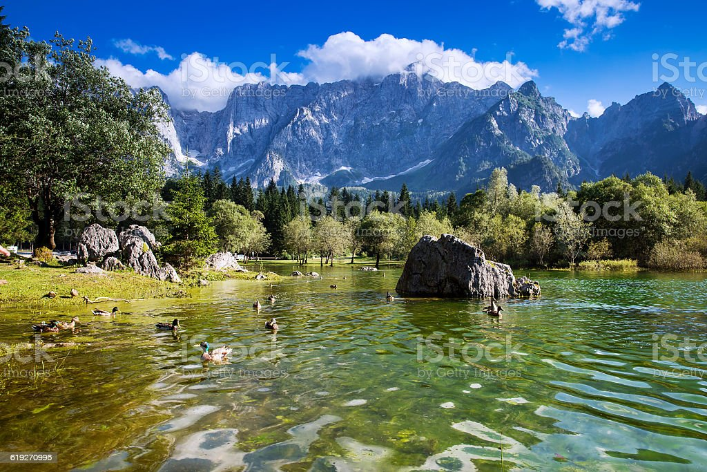 Lago di Fusine lake with Mangart mountains in the background. stock photo