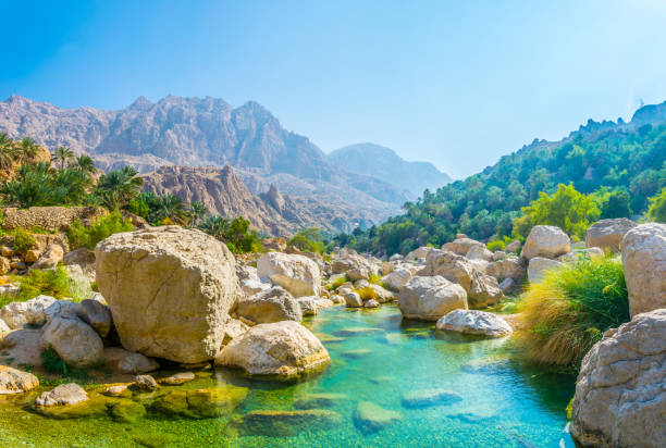 Lagoon with turqoise water in Wadi Tiwi in Oman. Lagoon with turqoise water in Wadi Tiwi in Oman. riverbed stock pictures, royalty-free photos & images
