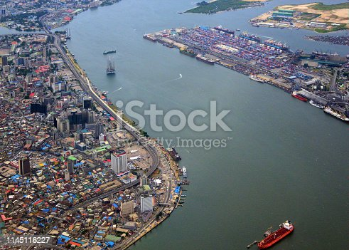 Lagos, Nigeria: the city from the air - Lagos island central business district, Victoria Island (top) andPort of Lagos (Apapa Port) container terminal (right) - view over Adeniji Adele Road and New Marina Road - the s-shaped Lagos Lagoon, Badagry Creek and Five Cowrie Creek - Gulf of Guinea, Atlantic Ocean in the backround.