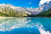 Andes mountains reflecting in lake Laguna Esmeralda near Ushuaia in Tierra del Fuego, Argentina