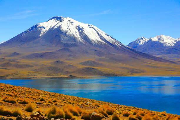 Lagunas Miñiques and Miscanti - Turquoise lake in volcanic Atacama Desert - Chile stock photo