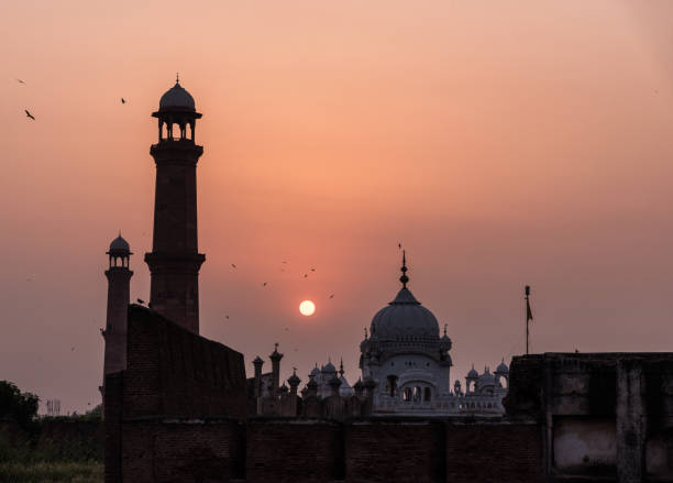 Lahore, Pakistan View of a sunset behind the Sikh Temple in Lahore, Punjab - Pakistan lahore pakistan stock pictures, royalty-free photos & images