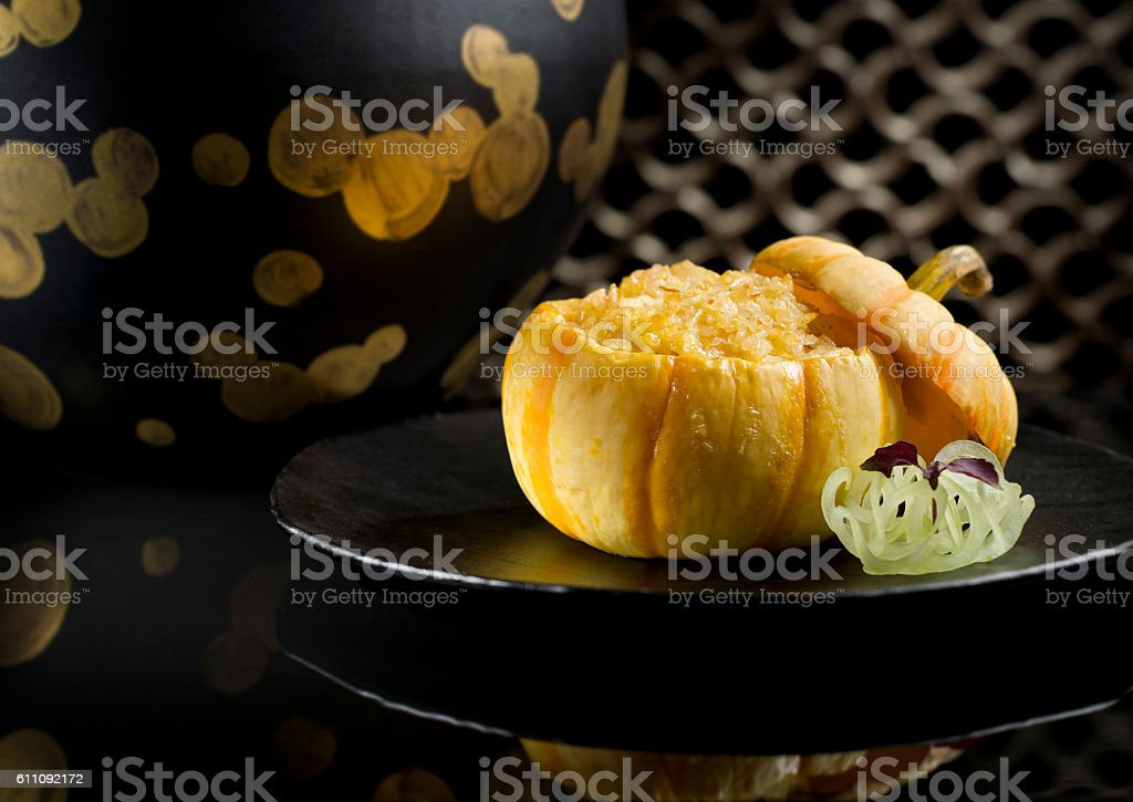 Lai Heen baked crispy fried rice with seafood in baby stock photo