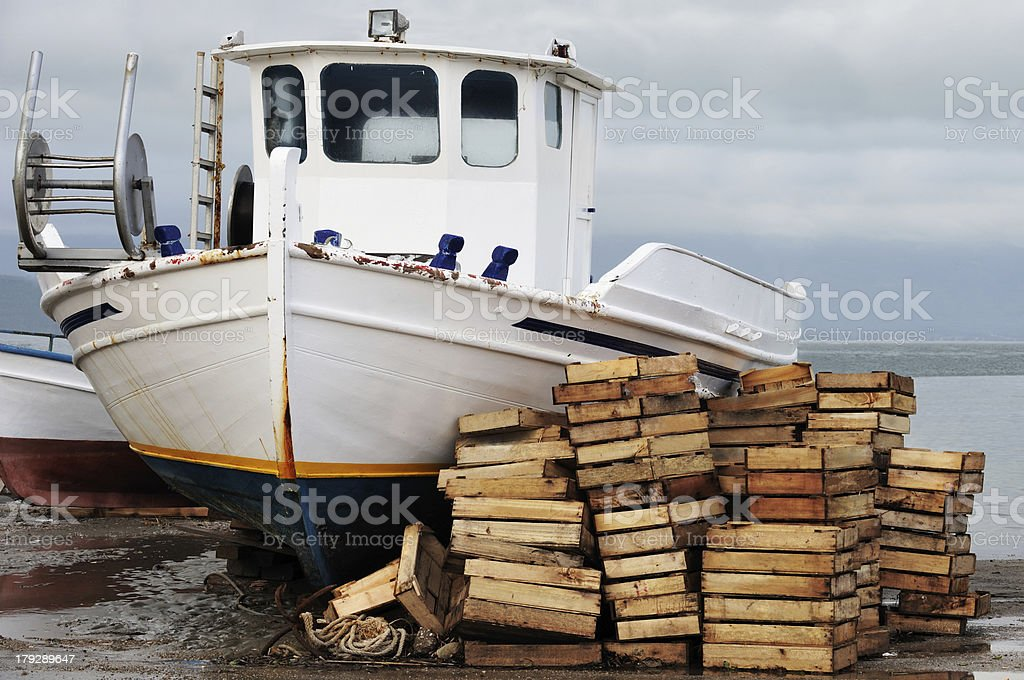 Laid out fishing boat stock photo