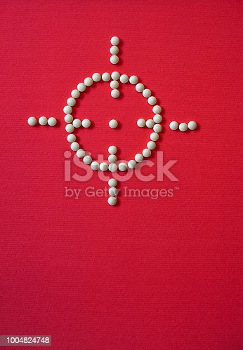 istock laid out sight and a target with pills and medications. The theme of health and saving lives. Stock Photo 1004824748